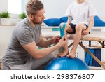 physical therapist applying... | Shutterstock . vector #298376807