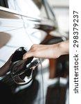 woman's hand open car door | Shutterstock . vector #298379237