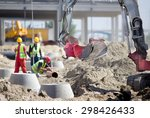 Small Excavator And Workers At...
