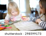 two little sisters drawing and... | Shutterstock . vector #298599173