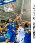 Small photo of TORONTO,CANADA-JULY 16, 2015:Toronto 2015 Pan Am or Pan American Games, Women basketball: Brazil's Karina Jacob (12) and Kelly Santos (15) try to avoid Alaina Coates (15) to score .CN 01953074