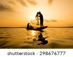 silhouette of a fisherman...   Shutterstock . vector #298676777