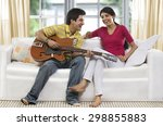 brother playing a song for his... | Shutterstock . vector #298855883
