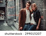 Young Man And Woman Posing Of...