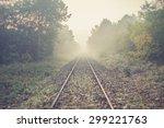 Railway Tracks In Misty Day
