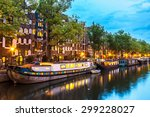 Stock photo canals of amsterdam at night amsterdam is the capital and most populous city of the netherlands 299228027