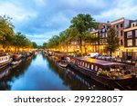 Stock photo canals of amsterdam at night amsterdam is the capital and most populous city of the netherlands 299228057
