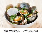 Clams Steamed In White Bowl On...