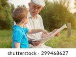 closeup of senior man reading... | Shutterstock . vector #299468627