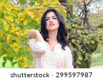 Young Latina Woman In Autumn