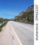 asphalt road in the mountains.... | Shutterstock . vector #299621237