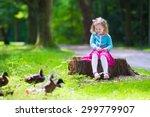 Little Girl Feeding Duck In A...