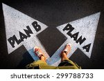 Small photo of Plan A and Plan B dilemma concept with man legs from above standing on signs