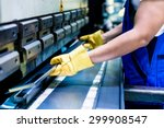 Asian Worker In Factory At...