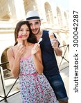 happy young couple tourist... | Shutterstock . vector #300042287
