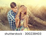 beauty couple relaxing on wheat ... | Shutterstock . vector #300238403