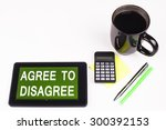 Small photo of Business Term / Business Phrase on Tablet PC - Cup of coffee, Pens, Calculator and a green/yellow note pad on a White surface - White Word(s) on a green background - Agree To Disagree