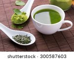 Stock photo green tea n the brown mat close up 300587603