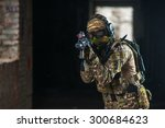 Small photo of airsoft soldier with a rifle playing strikeball