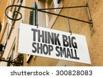 Small photo of Think Big Shop Small sign in a conceptual image