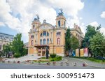 Small photo of National Romanian Theater and Opera House in Cluj Napoca city in the Transylvania region of Romania in a baroque architectural style on a sunny summer day