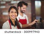 portrait of a waitress using... | Shutterstock . vector #300997943