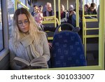 Woman Sitting On The Bus ...