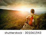 Young Woman Hiker Sits On The...