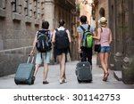 American Tourists Walking The...