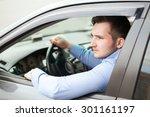 handsome man in his new car | Shutterstock . vector #301161197