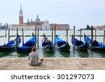 Tourist Sitting In San Marco...