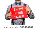 Small photo of Man holding a card with the text Show your talent on white background