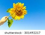 happy sunflower in the hand... | Shutterstock . vector #301492217