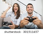 young couple playing video game | Shutterstock . vector #301511657