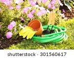 garden tools on green grass in... | Shutterstock . vector #301560617