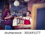 smiling waiter serving a client ... | Shutterstock . vector #301691177