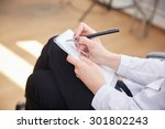 business woman with a notebook... | Shutterstock . vector #301802243