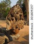 Small photo of Naga serpent snake head statue at the Royal reservoir Sra Srang, Cambodia