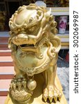 Chinese Lion Statue In Front O...