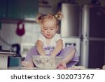beautiful little girl learns to ... | Shutterstock . vector #302073767