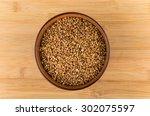 dry buckwheat in brown ceramic... | Shutterstock . vector #302075597