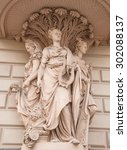 Small photo of Allegorical figures - Fertility, Art, Commerce decorated old house on the street in St. Petersburg