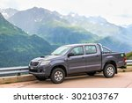 Small photo of GOTTHARD PASS, SWITZERLAND - AUGUST 5, 2014: Motor car Toyota Hilux at the high Alpine mountain road.