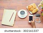 businesswoman hand holding a...   Shutterstock . vector #302161337