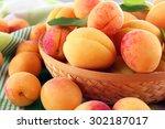 Ripe Apricots In Wicker Bowl O...