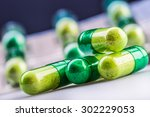 green yellow pills or capsule... | Shutterstock . vector #302229053