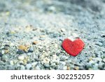 Heart Shaped Stone On The Sand