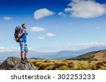 guy with a travel backpack on...   Shutterstock . vector #302253233