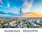 Stock photo aerial view of berlin skyline with famous tv tower at alexanderplatz and dramatic cloudscape at 302414933
