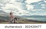 traveler woman sits on retro... | Shutterstock . vector #302420477